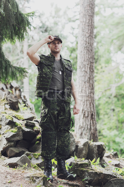young soldier or ranger in forest Stock photo © dolgachov