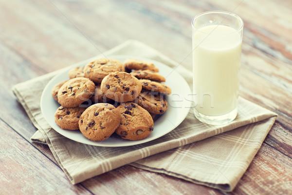 Közelkép csokoládé kása sütik tej étel Stock fotó © dolgachov