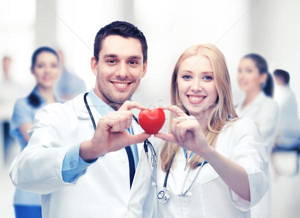 cardiologists with heart Stock photo © dolgachov