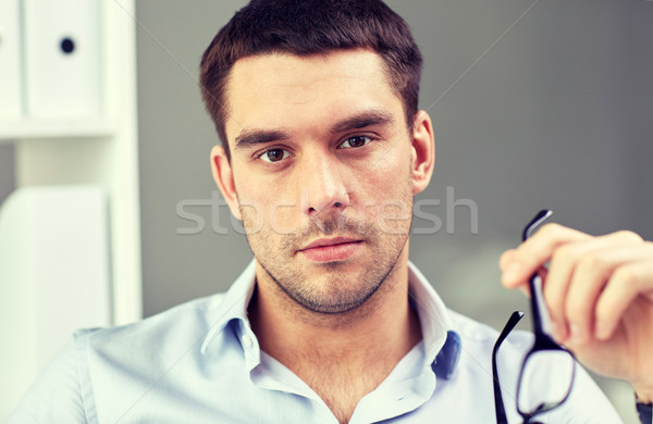 Stock photo: portrait of businessman with eyeglasses at office