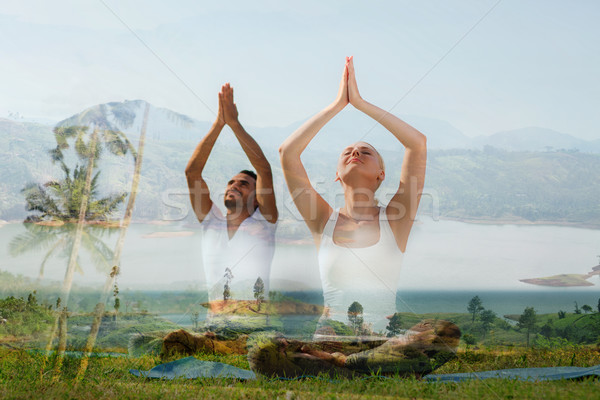 smiling couple making yoga exercises outdoors Stock photo © dolgachov
