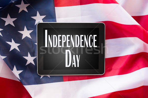 close up of tablet pc on american independence day Stock photo © dolgachov