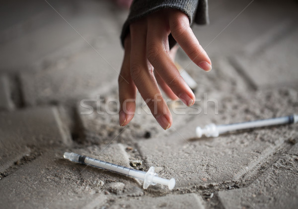 close up of addict woman hands and drug syringes Stock photo © dolgachov