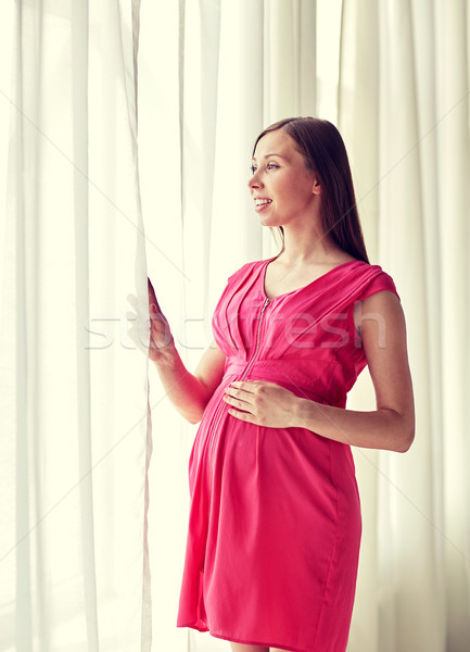 happy pregnant woman with big tummy at home Stock photo © dolgachov