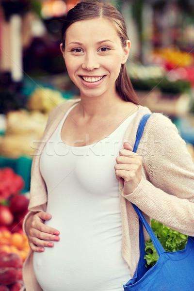 happy pregnant woman with bag at street market Stock photo © dolgachov