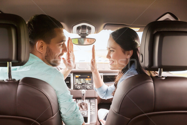 happy man and woman driving in car Stock photo © dolgachov