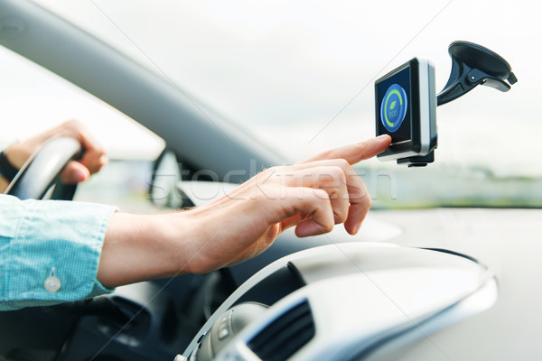 close up of man with gadget on screen driving car Stock photo © dolgachov