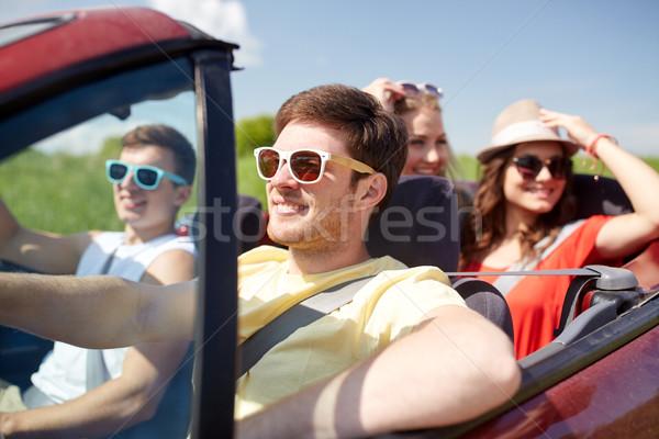 happy friends driving in cabriolet car Stock photo © dolgachov