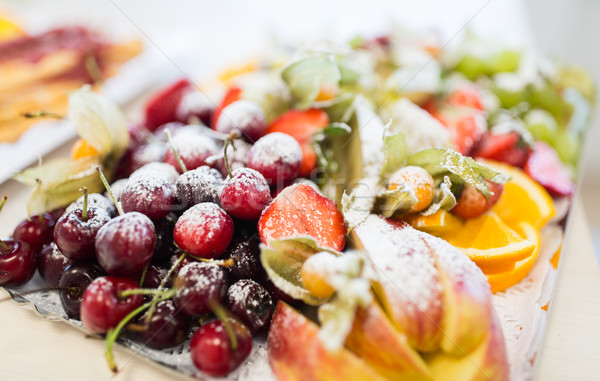 Stock photo: close up of dish with sugared fruit dessert