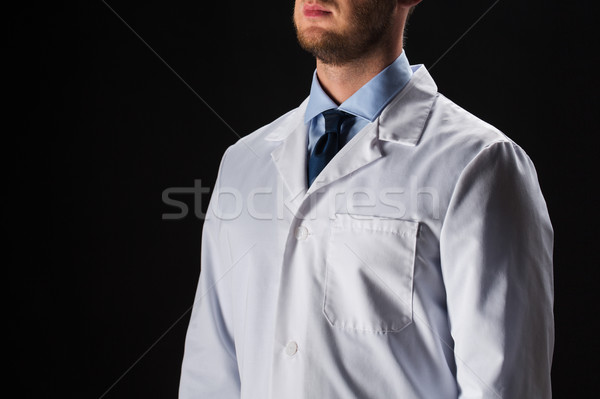 close up of male doctor in white coat Stock photo © dolgachov