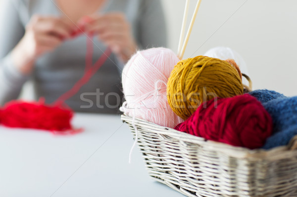 woman, basket with knitting needles and yarn balls Stock photo © dolgachov
