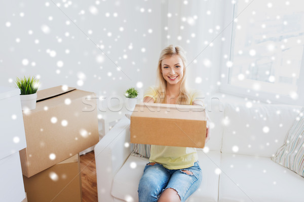 smiling young woman with cardboard box at home Stock photo © dolgachov