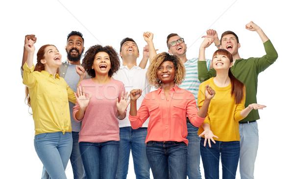 international group of happy smiling people Stock photo © dolgachov
