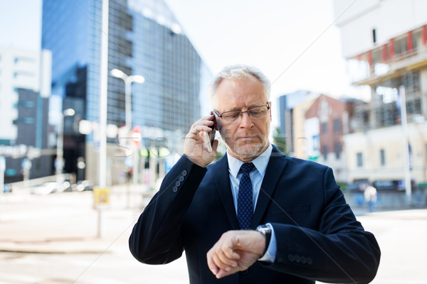 senior businessman calling on smartphone in city Stock photo © dolgachov