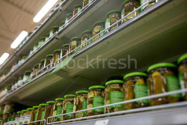соленья продуктовых супермаркета Полки продажи торговых Сток-фото © dolgachov