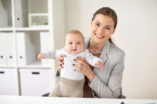 happy businesswoman with baby at office Stock photo © dolgachov