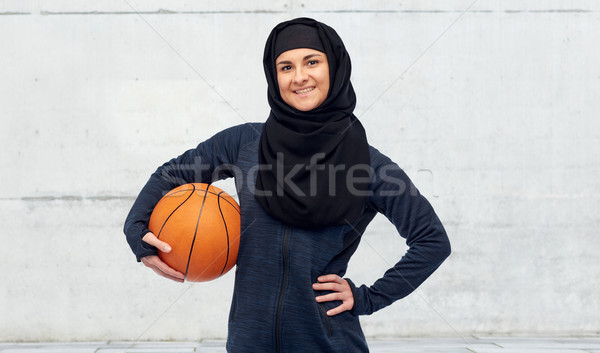 happy muslim woman in hijab with basketball Stock photo © dolgachov