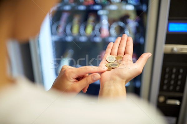 woman counting euro coins at vending machine Stock photo © dolgachov