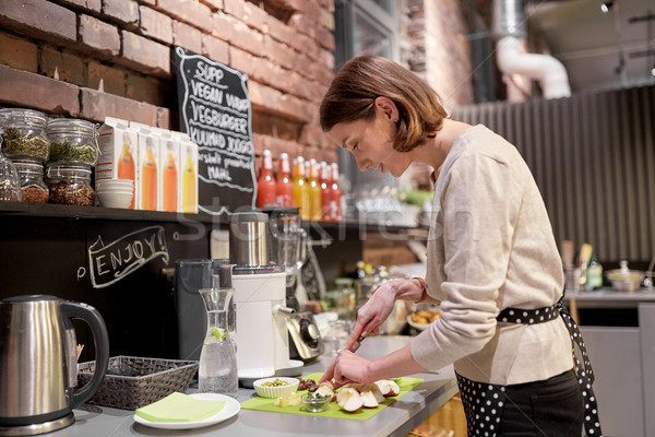 happy woman or barmaid cooking at vegan cafe Stock photo © dolgachov