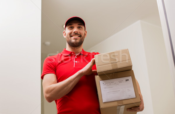 delivery man with parcel boxes at customer door Stock photo © dolgachov