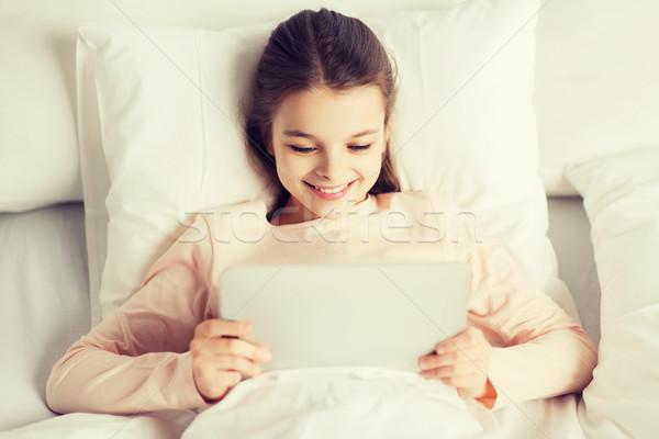счастливая девушка кровать домой люди детей Сток-фото © dolgachov
