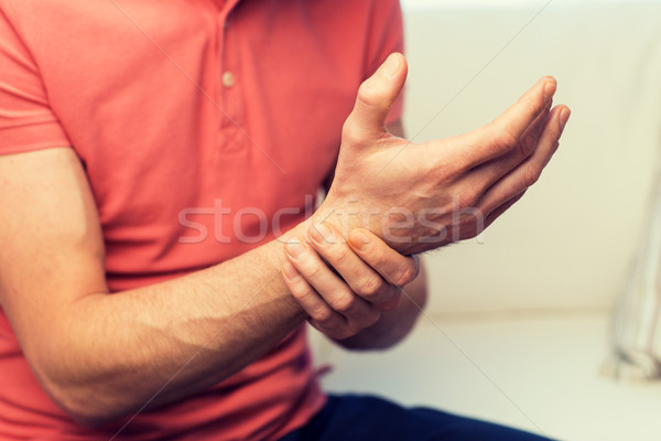 Man pijn hand home mensen Stockfoto © dolgachov