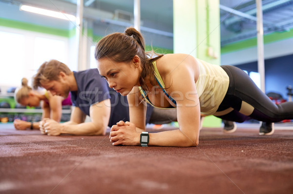woman with heart-rate tracker exercising in gym Stock photo © dolgachov