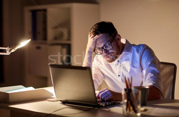 businessman with laptop thinking at night office Stock photo © dolgachov