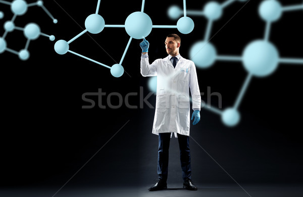 scientist in lab coat with molecules Stock photo © dolgachov