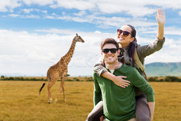 happy couple with backpacks having fun in africa Stock photo © dolgachov
