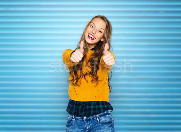 happy young woman or teen girl showing thumbs up Stock photo © dolgachov
