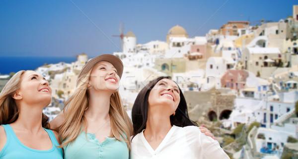 Szczęśliwy kobiet santorini wyspa podróży turystyki Zdjęcia stock © dolgachov