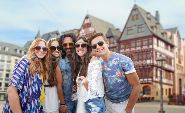 happy hippie friends taking selfie in frankfurt Stock photo © dolgachov