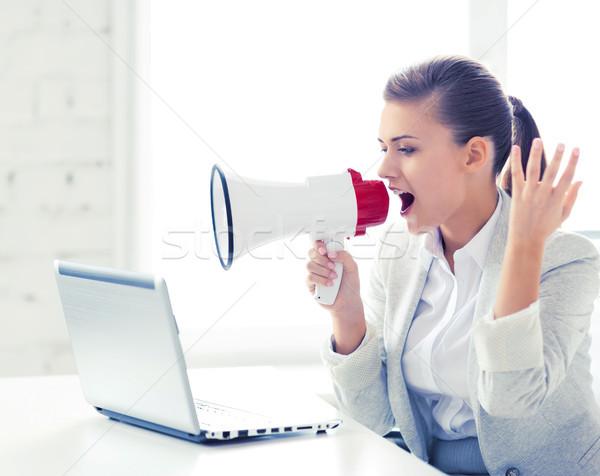 strict businesswoman shouting in megaphone Stock photo © dolgachov