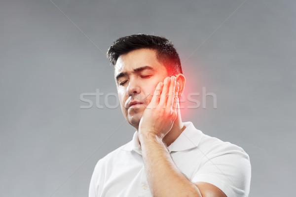 Infeliz homem sofrimento dor de dente pessoas saúde Foto stock © dolgachov