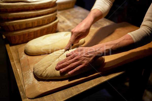 Baker pain boulangerie alimentaire Photo stock © dolgachov
