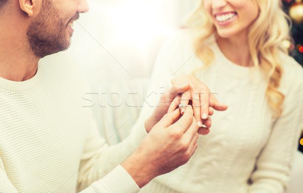 Homme bague en diamant femme Noël amour couple Photo stock © dolgachov