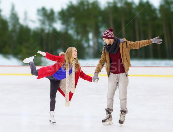 Boldog pár kéz a kézben korcsolyázás pálya tél Stock fotó © dolgachov