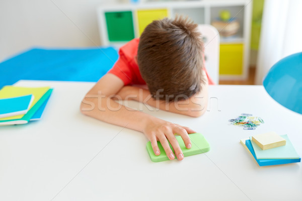 tired or sad student boy with smartphone at home Stock photo © dolgachov
