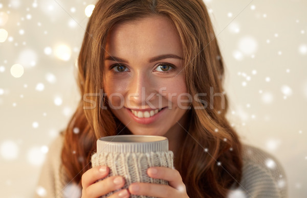 close up of woman with tea or coffee cup at home Stock photo © dolgachov