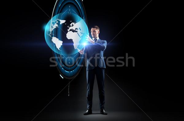 ビジネスマン 地球 ホログラム 黒 ビジネスの方々  現実 ストックフォト © dolgachov