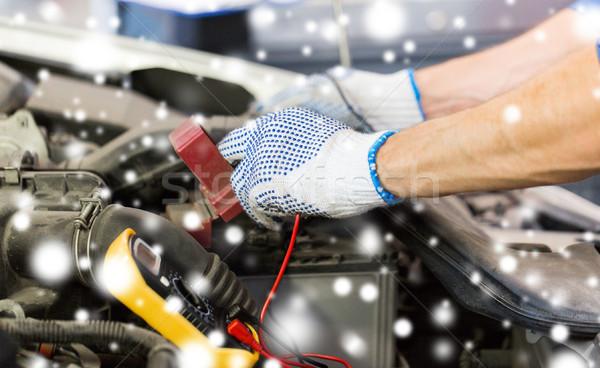 auto mechanic with multimeter testing battery Stock photo © dolgachov