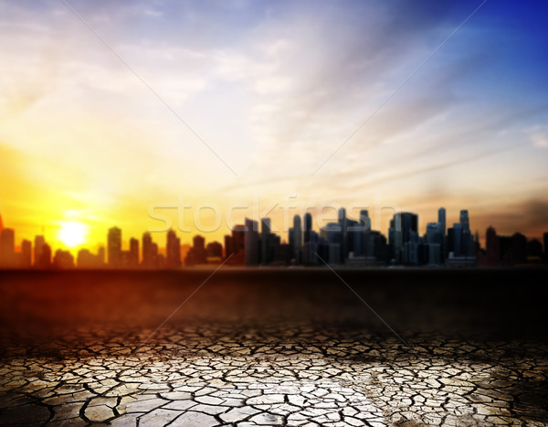 cracked desert surface over sunset in city Stock photo © dolgachov