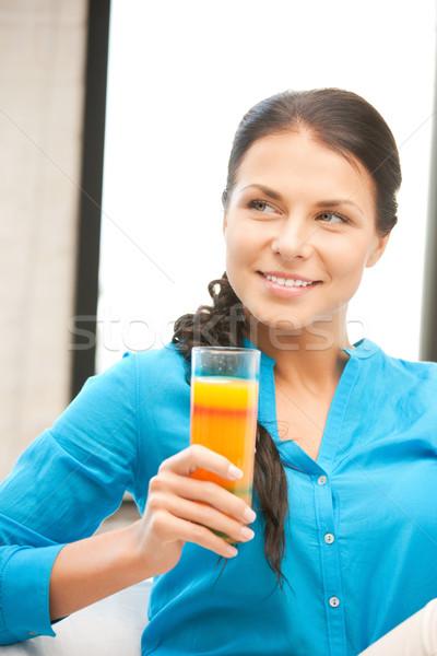 Сток-фото: красивая · женщина · стекла · сока · фотография · женщину · оранжевый