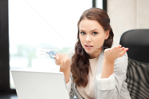 unhappy woman with laptop computer and euro cash money Stock photo © dolgachov