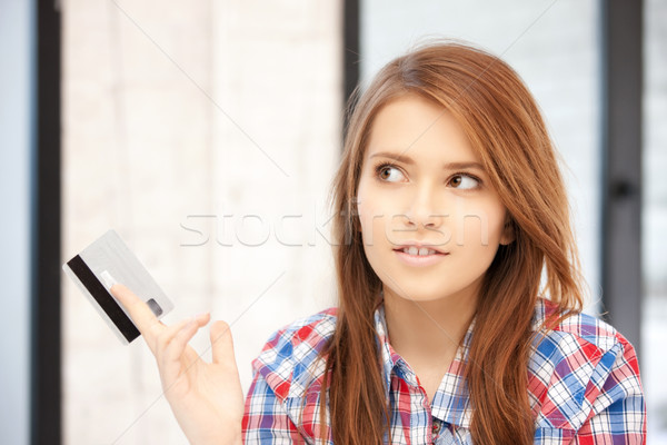 pensive woman with credit card Stock photo © dolgachov