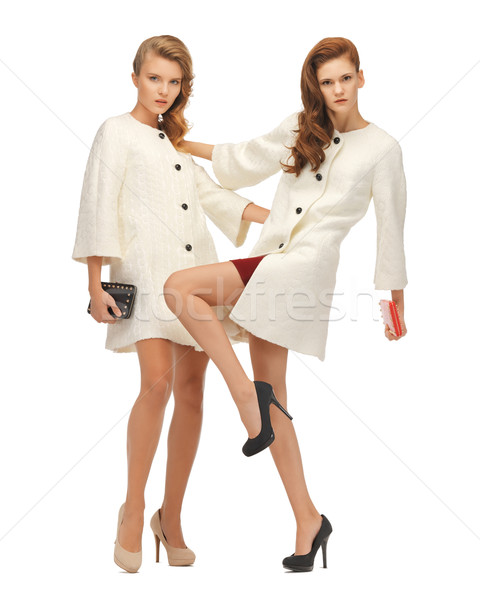 two teenage girls in white coats with clutches Stock photo © dolgachov