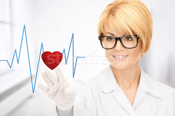 Stock photo: doctor pressing virtual button with heart diagram