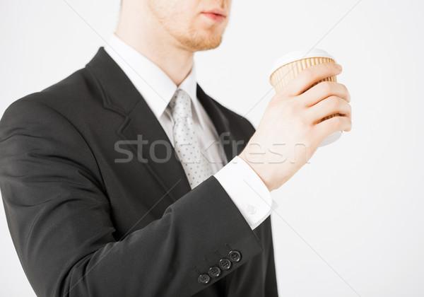 man hand holding take away coffee Stock photo © dolgachov