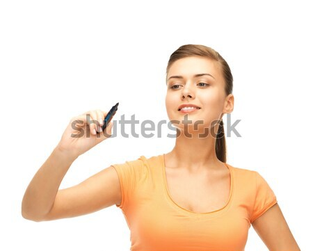 woman writing something in the air Stock photo © dolgachov